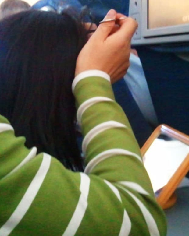public grooming: woman plucking grey hairs on a five-hour flight