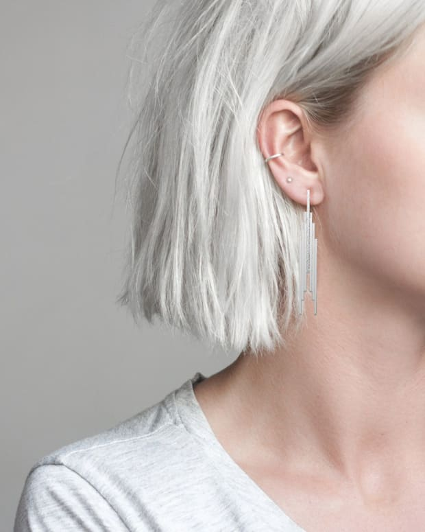 young woman white hair silver earrings_clean behind your ears