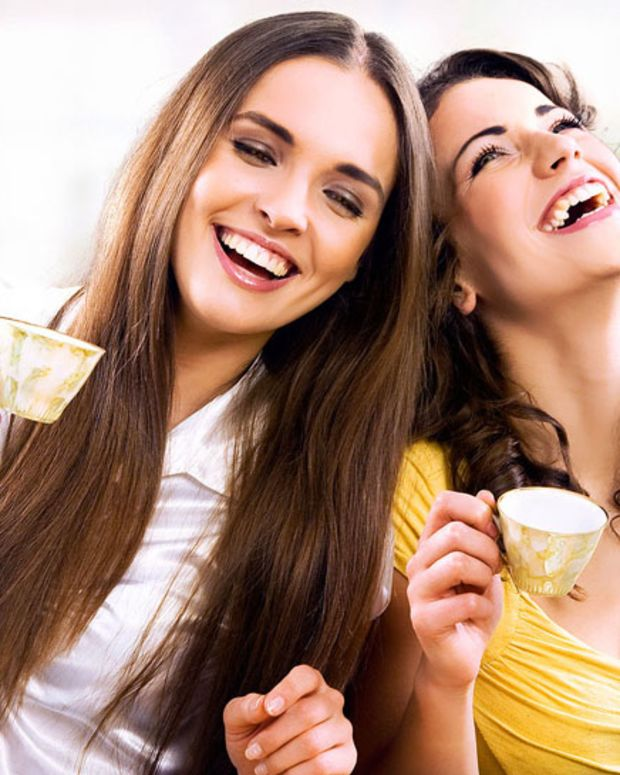 bigstock_Two_smiling_girls_have_coffee__12123947