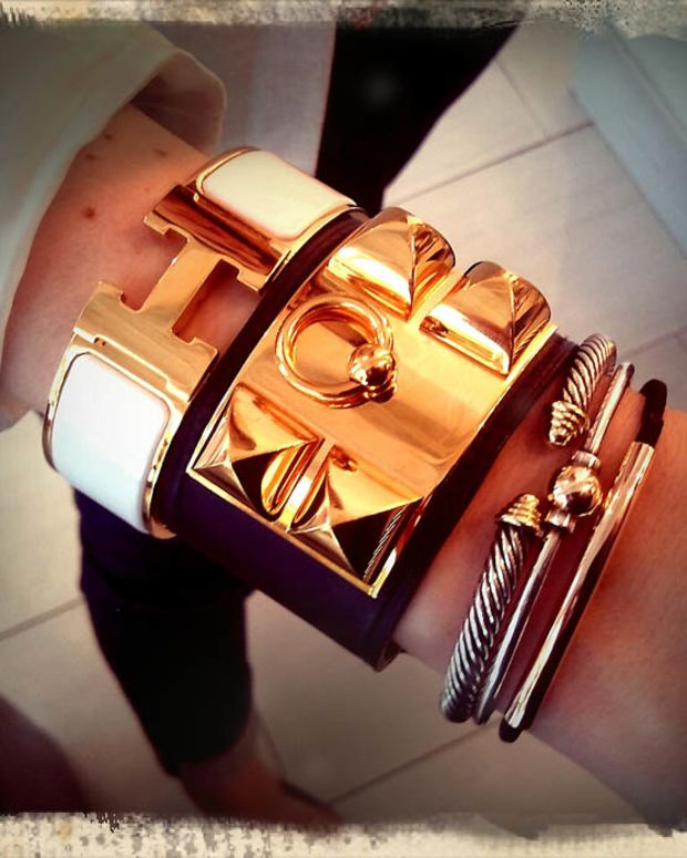 Elyn's Hermès Clic-Clac and Collier de Chien bangles, David Yurman Cable Cuff, Cape Cod Dennis bracelet, Goody Doublewear Elastic