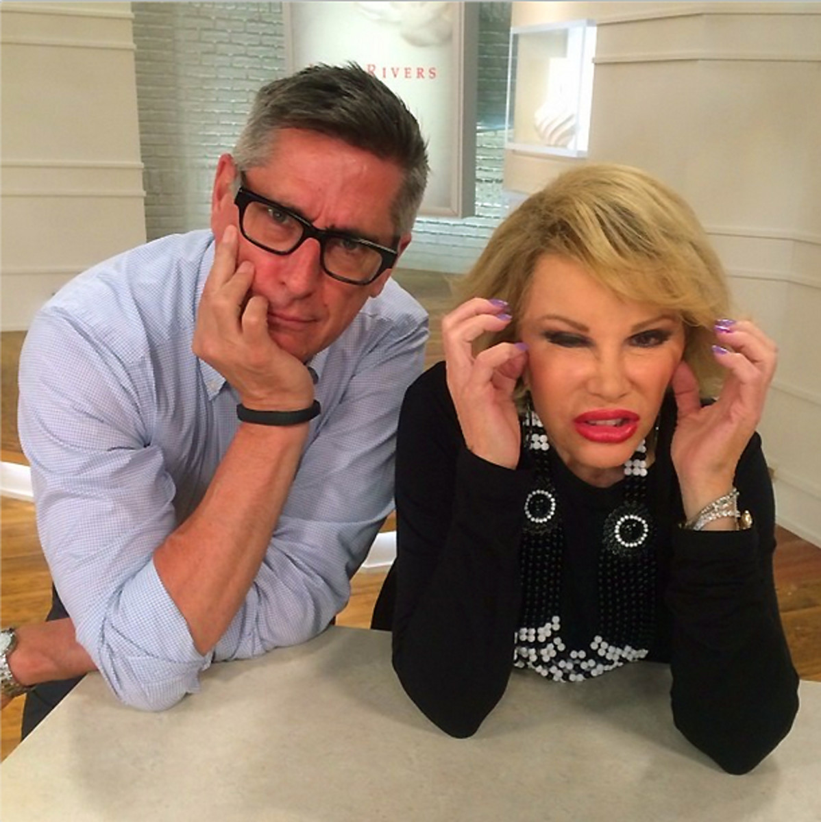 Joan Rivers with her CEO David Dangle on the QVC set
