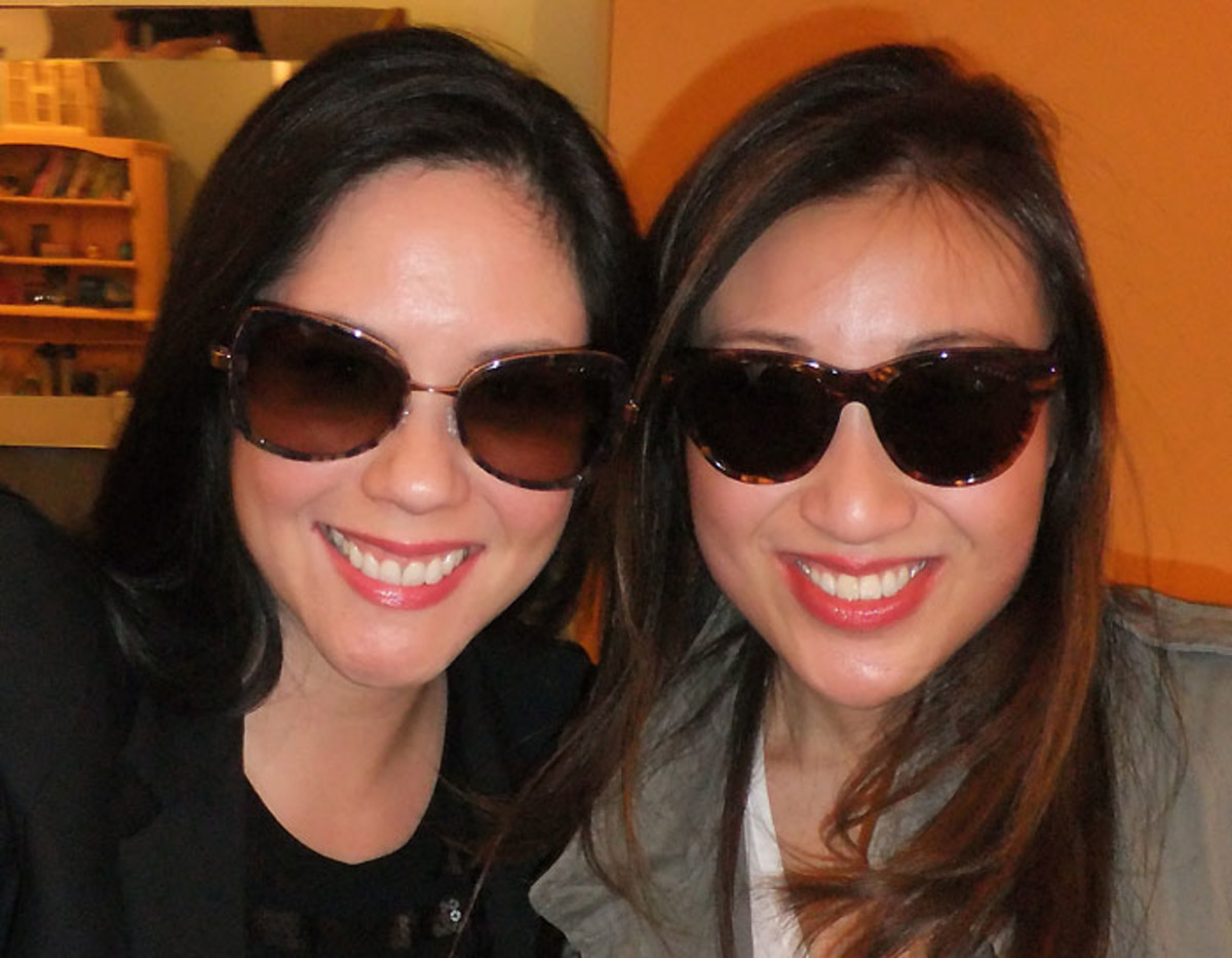 I'm in KayTran Celine frames in Rose Gold/Plum Tortoise; Kathy's wearing Aiden in Amber Honey.