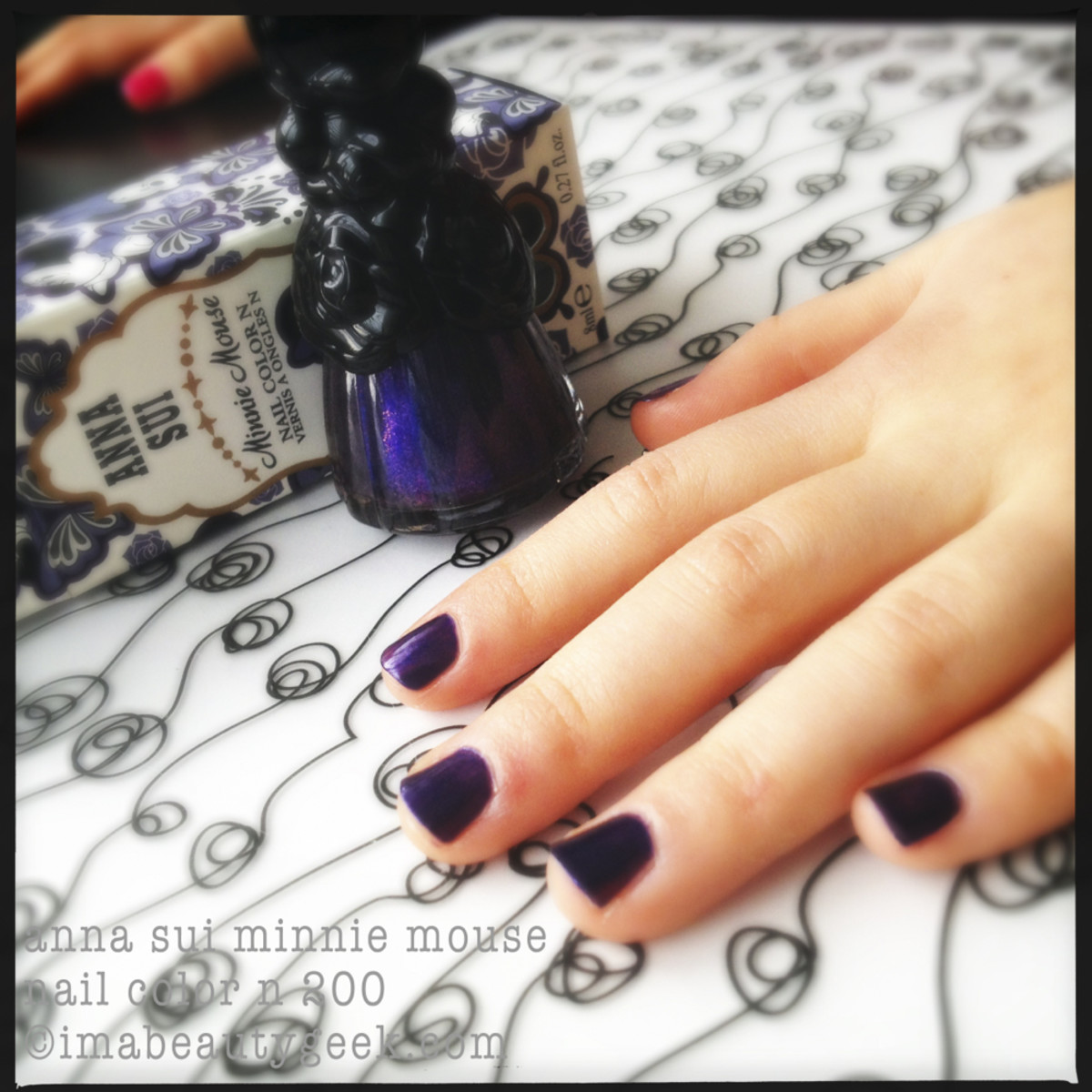 Anna Sui Minnie Mouse nail polish and little fingers