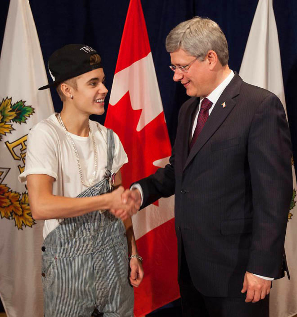 Canadian Justin Bieber receives a Diamond Jubilee Medal from Canadian Prime Minister Stephen Harper
