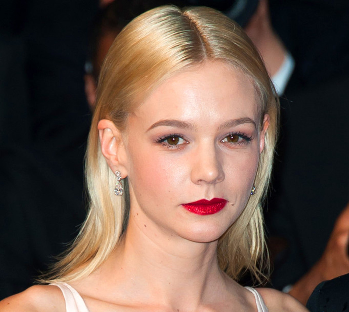 Carey Mulligan as a blonde: her pale hair makes her brown eyes look quite dark. Hair-colour legend Christophe Robin (he works with Catherine Deneuve and a host of other A-listers) says light hair with dark eyes can emphasize dark circles and under-eye wrinkles.