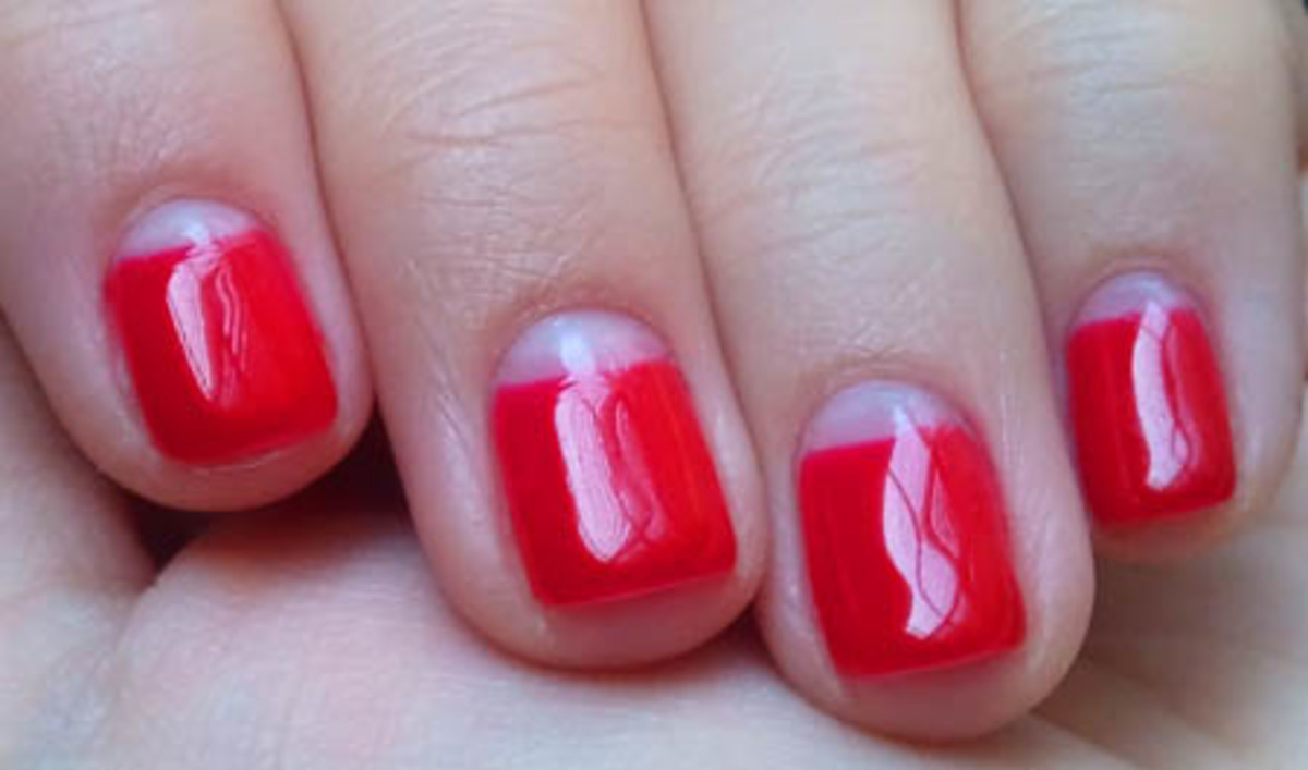 Empty-moon-mani-by-Leeanne-Colley-of-Tips_OPI-Axxium-in-Big-Apple-Red_beautygeeks.jpg
