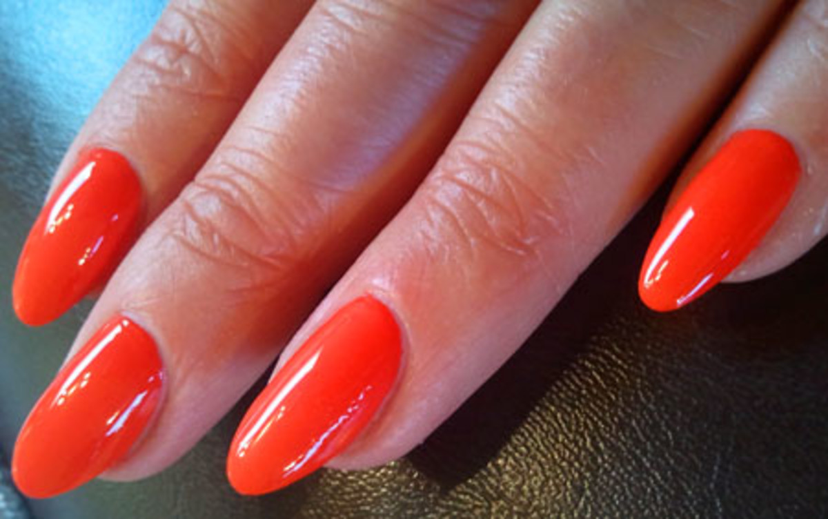 pointy oval nails_BEAUTYGEEKS_imabeautygeek.com_CND Electric Orange_Tips Nail Bar.jpg