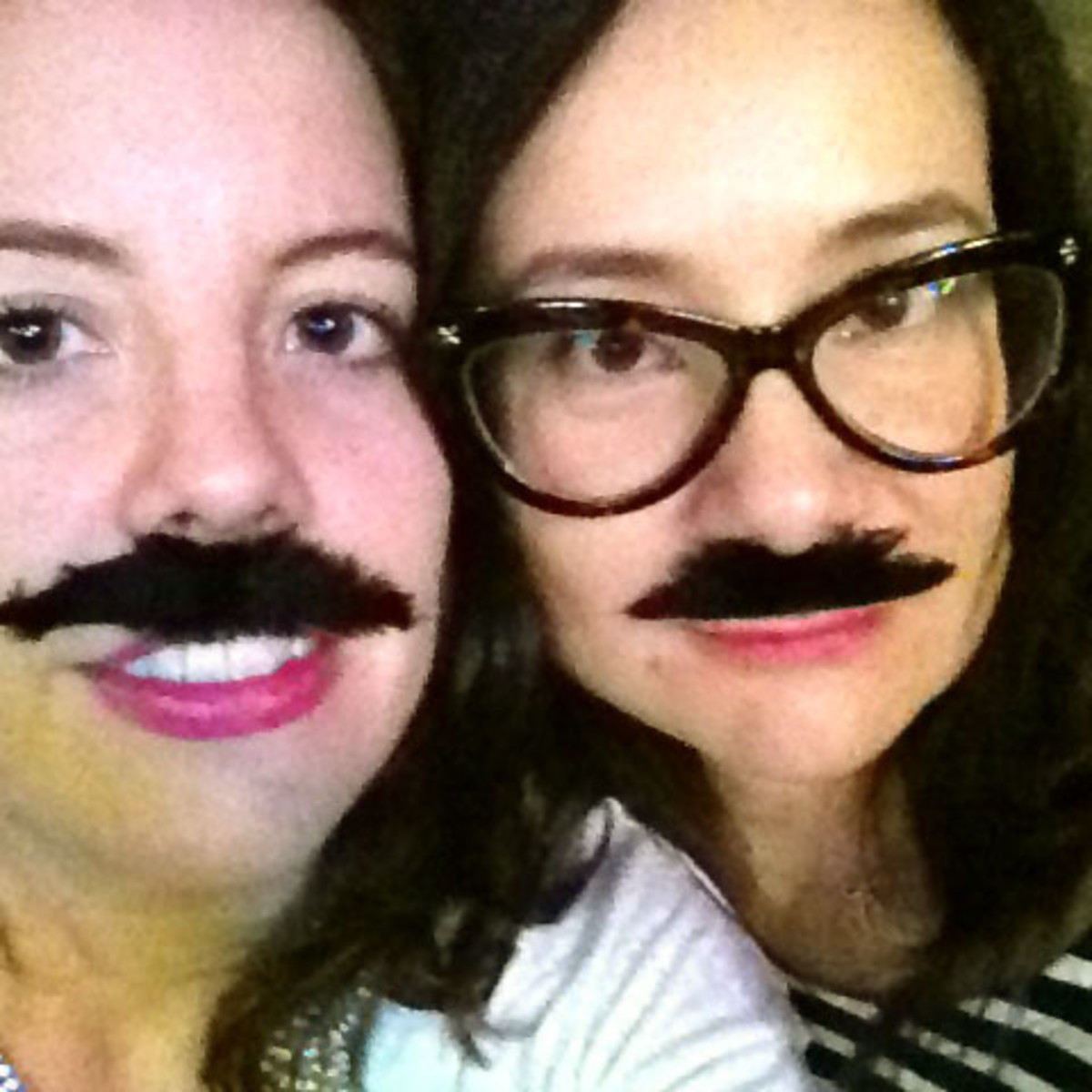 Moustache removal: Elle Canada beauty editor Katherine Flemming and Fashion Magazine beauty director Lesa Hannah can just lift their stick-on 'staches off.