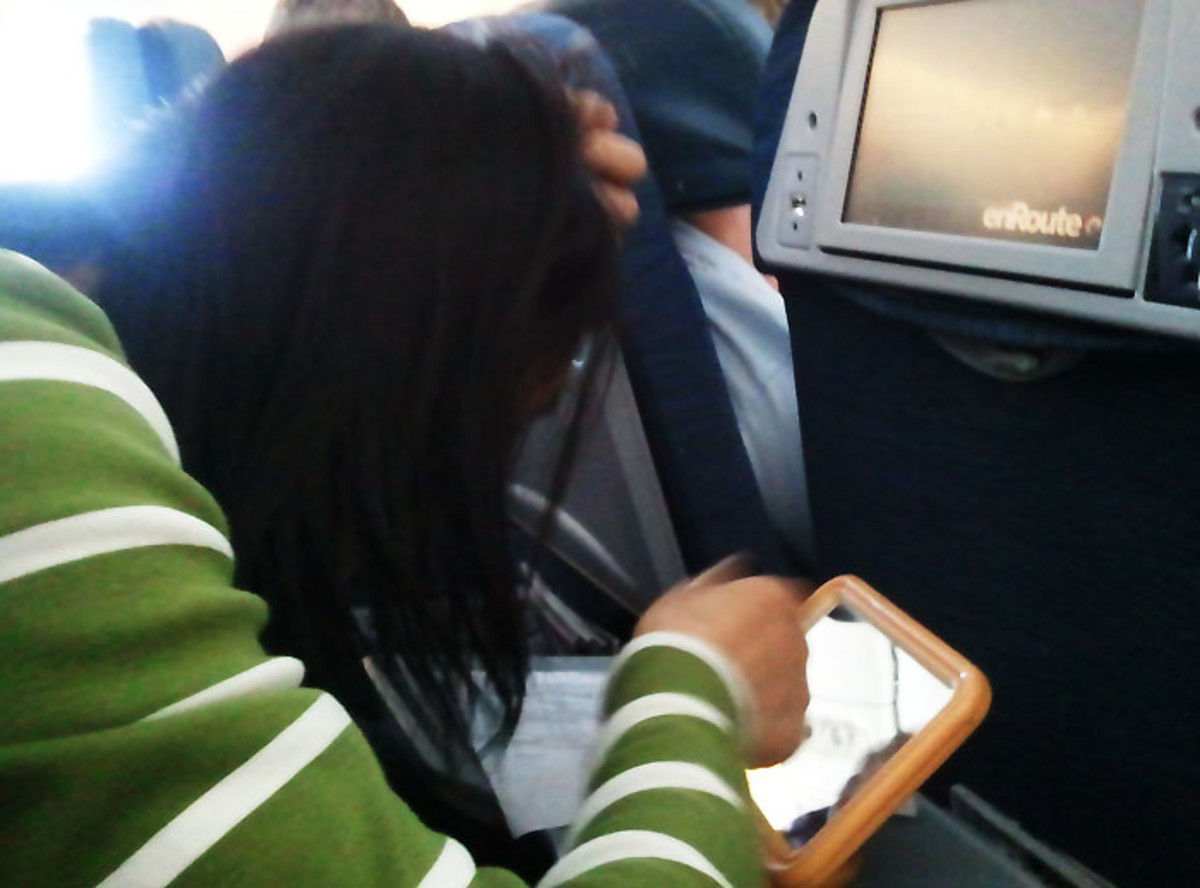 public grooming: woman plucking grey hairs on a five hour flight