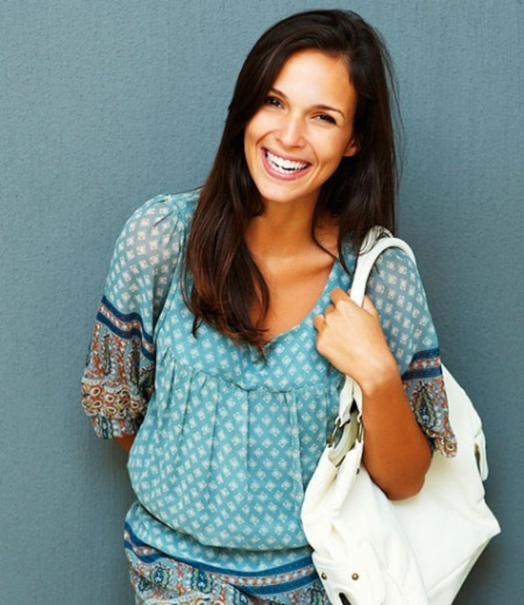 bigstock_Friendly_Brunette_With_Purse_O_10741913-450x519
