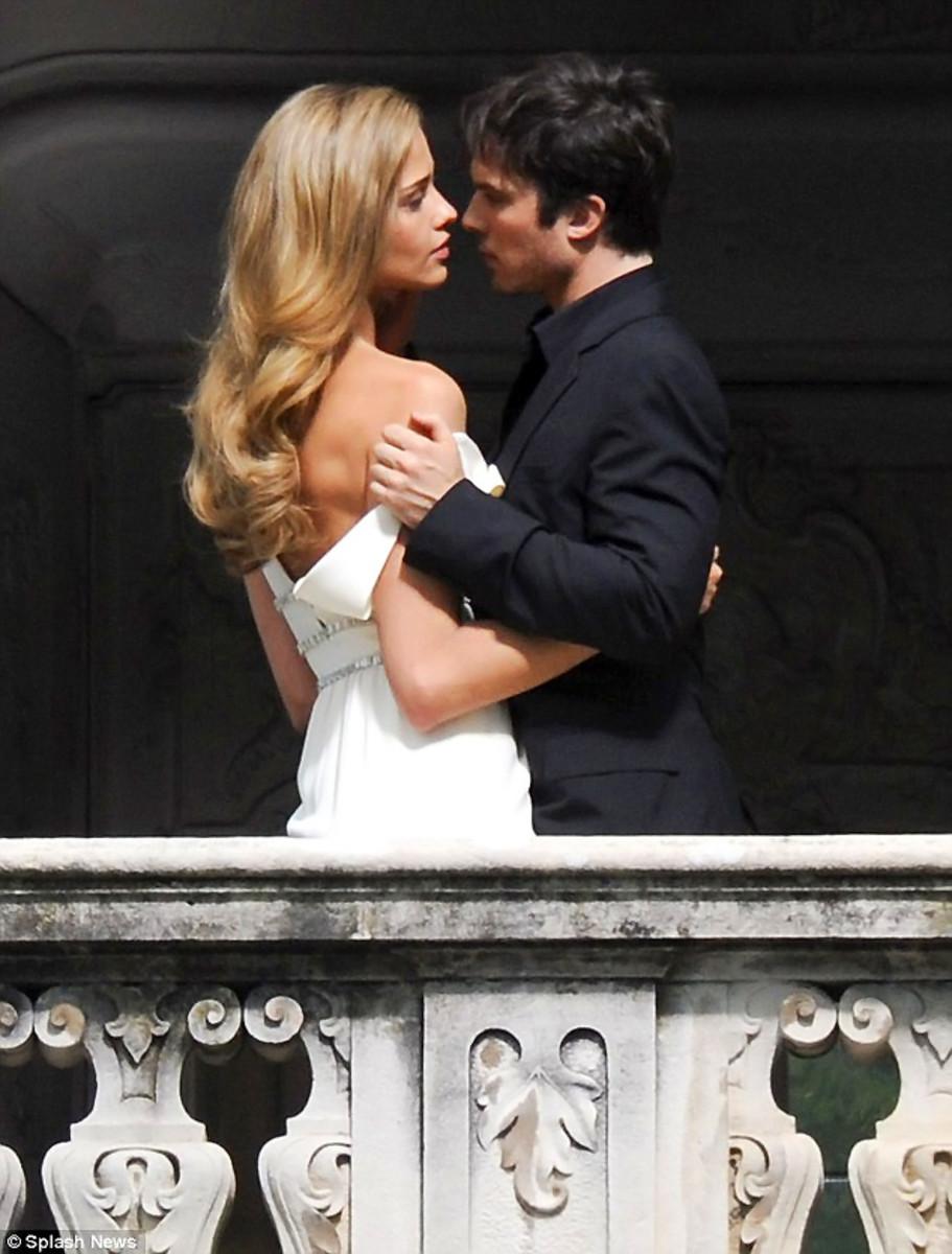 Ana Beatriz Barros and Ian Somerhalder heat up the Lake Como balcony.