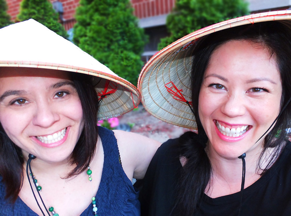 Angela and Janine_rice paddy hats