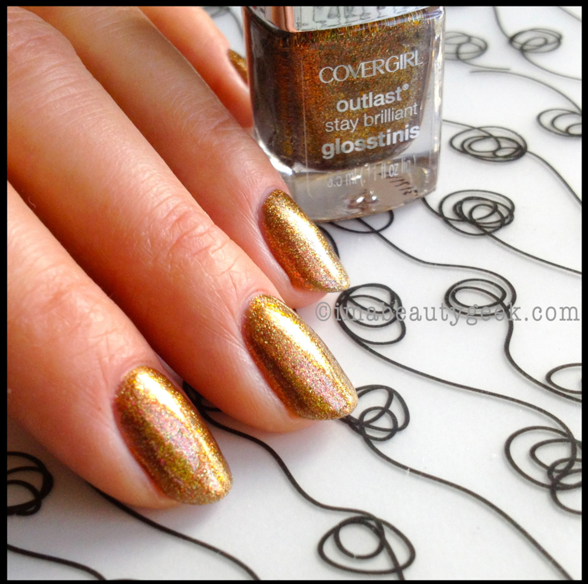 Hunger Games Catching Fire CoverGirl Glosstinis Capitol Collection Glosstinis Seared Bronze