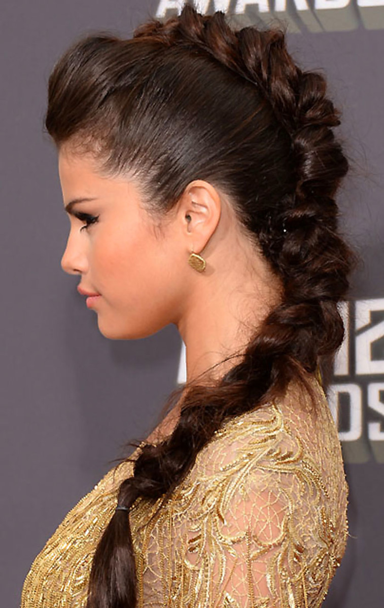 Creating five braids instead of one dutch braid keeps the sides of the hair smooth and free of visible parts.