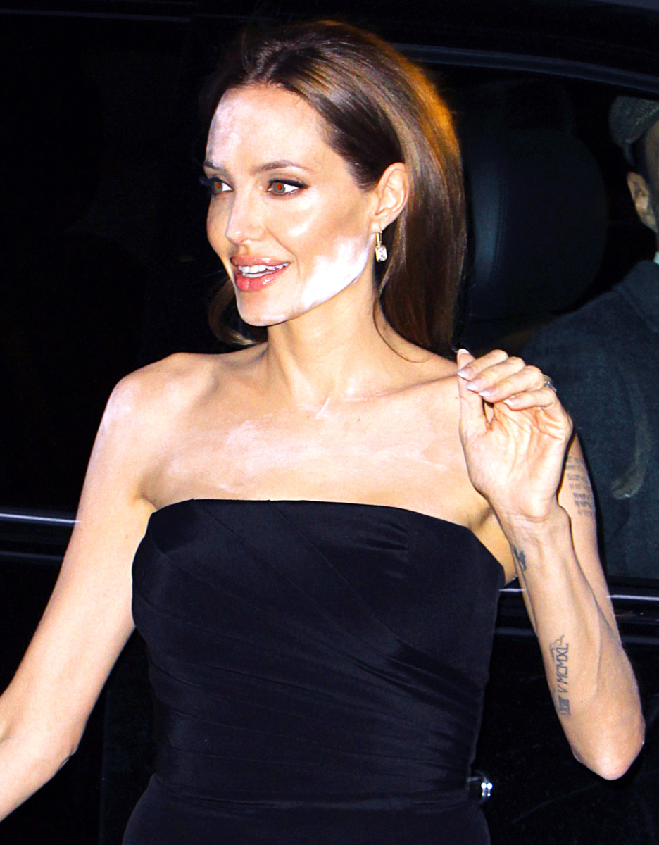 "Angelina Jolie suffers a white powdered makeup malfunction while attending a screening for HBO's ""The Normal Heart"" with partner Brad Pitt in NYC."