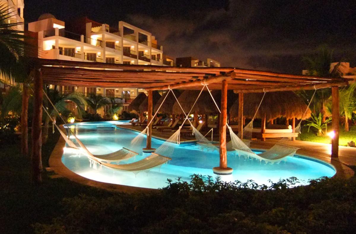 Excellence Playa Mujares_night pool hammocks
