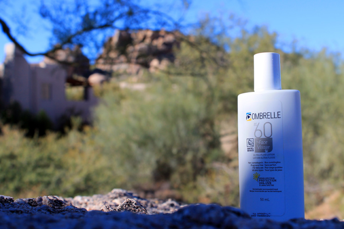 How to avoid vacation sunburn: Ombrelle Face Ultra Fluid SPF 60 on the rocks.