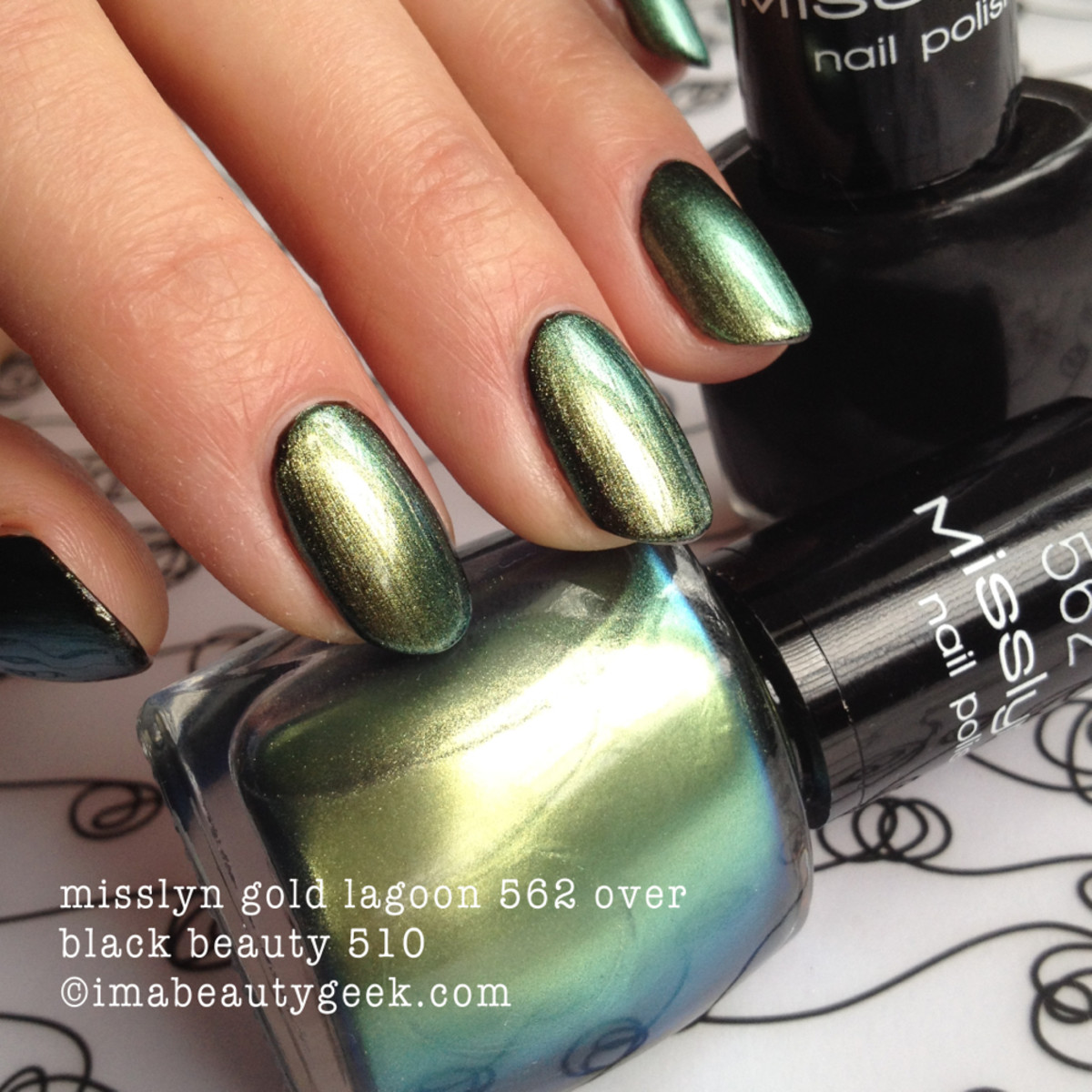Misslyn Gold Lagoon 562 over black