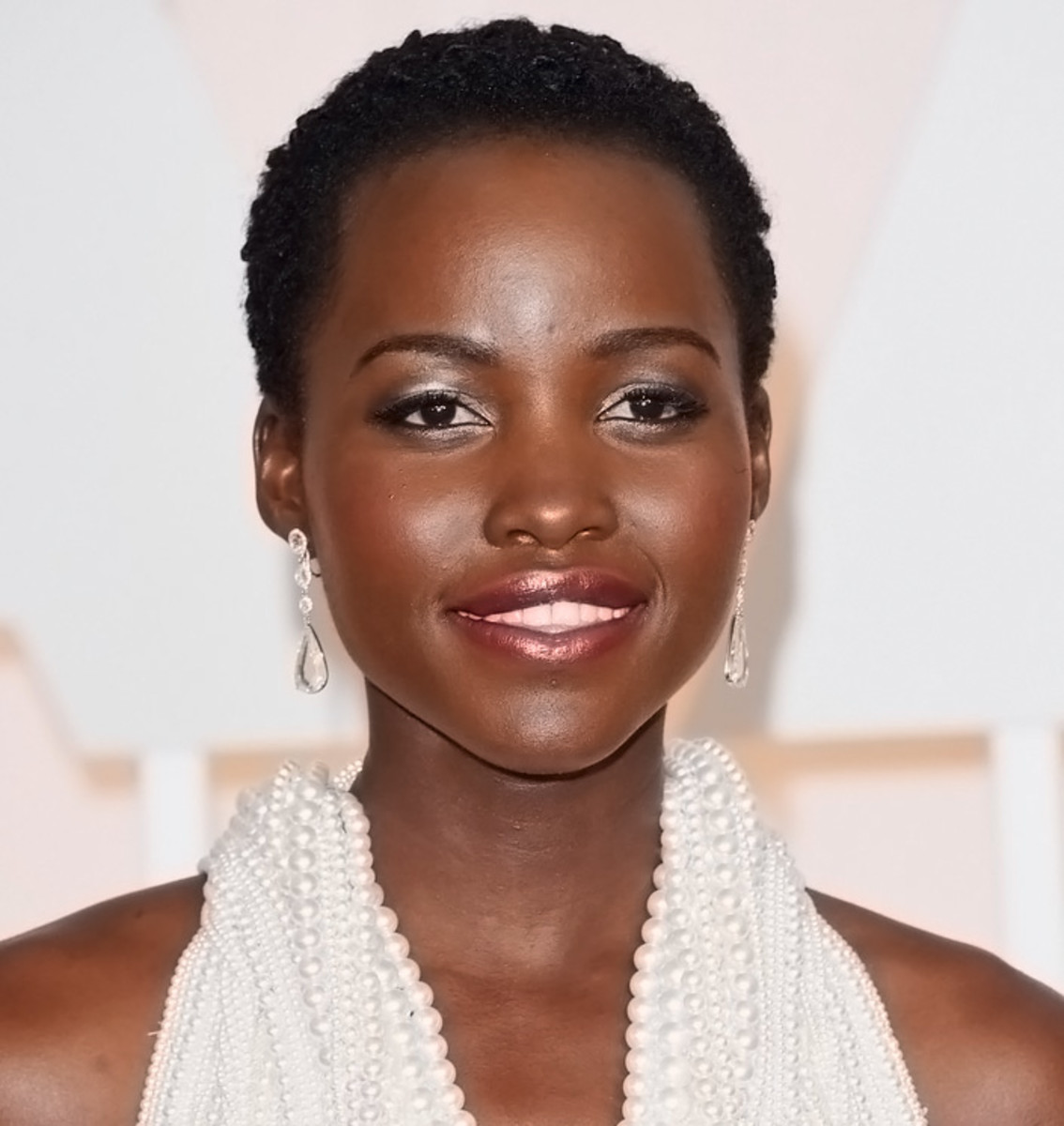 Lupita Nyong'o at the 2015 Oscars: makeup pro Nick Barose prepped her lips with Kiehls Lip Balm