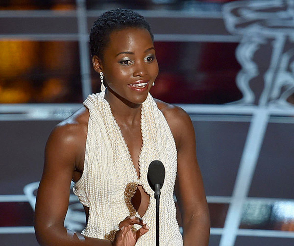 Lupita Nyong'o presents at the 2015 Oscars