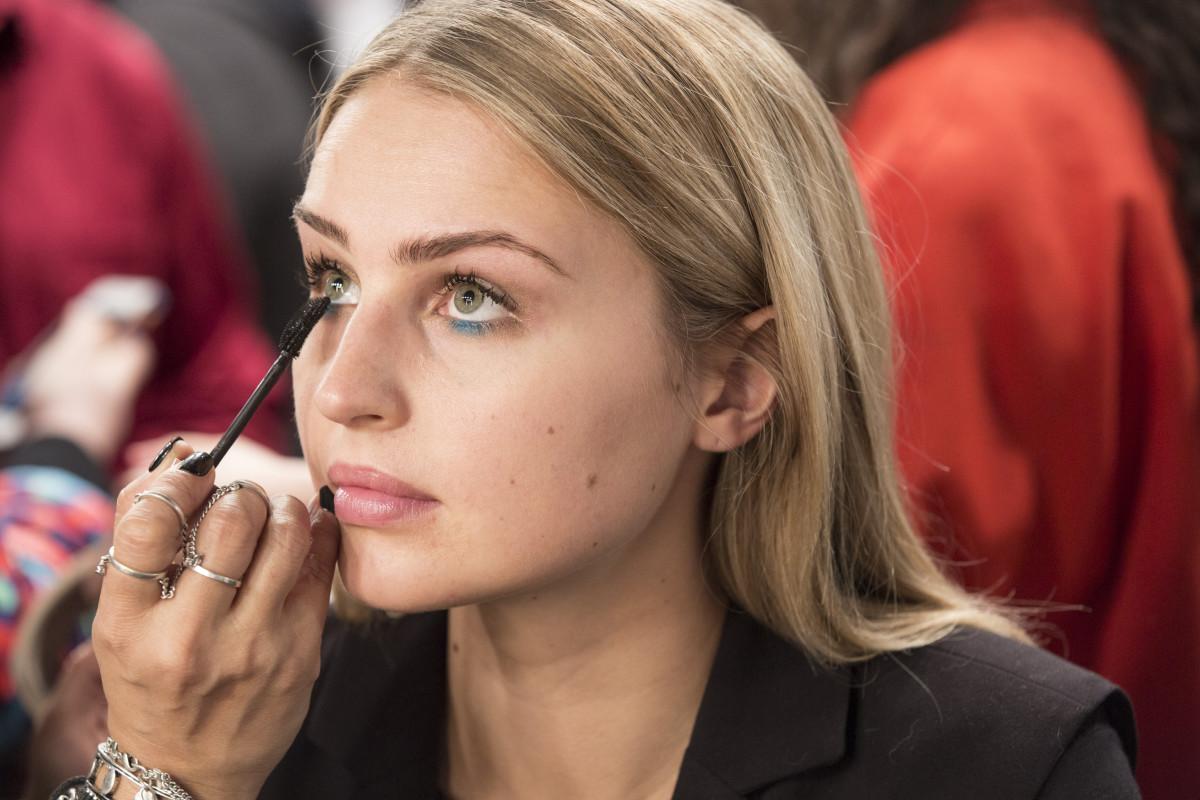 Finish eyes with black mascara on top and bottom lashes.