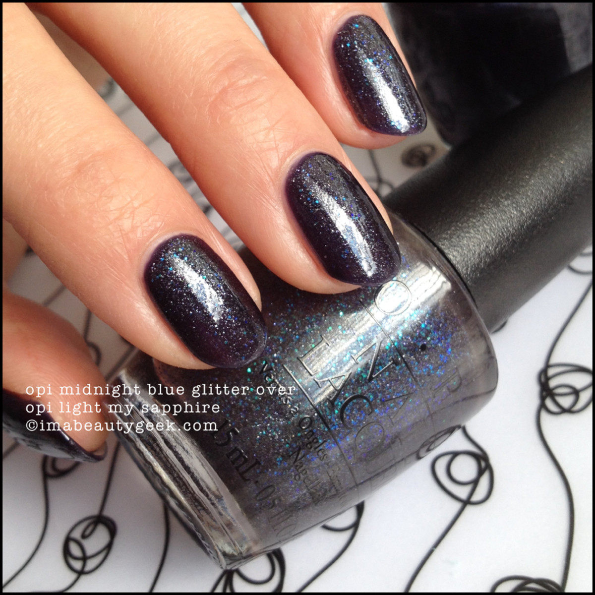 OPI Midnight Blue Glitter over OPI Light My Sapphire Beautygeeks