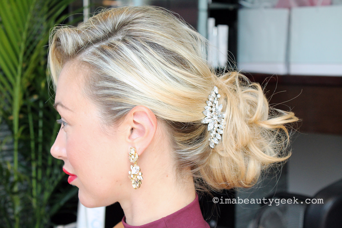 The one-minute updo: a speedy transformation from long tumbling waves to this tousled chignon.