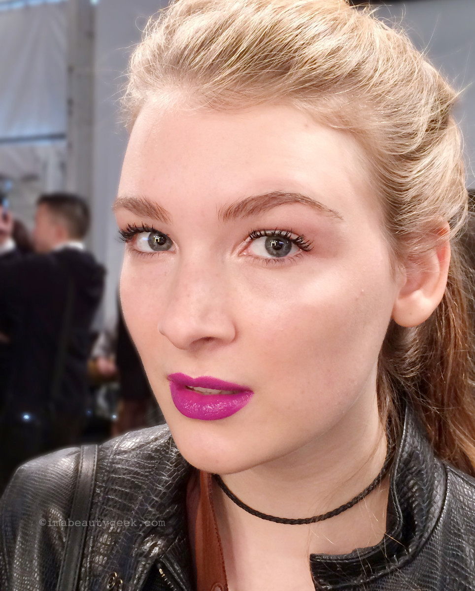 Model Sadie wears Maybelline Color Jolt Intense Lip Paint in Violet Rebel, Master Strobing Stick and Colossal Spider Effect Lashes