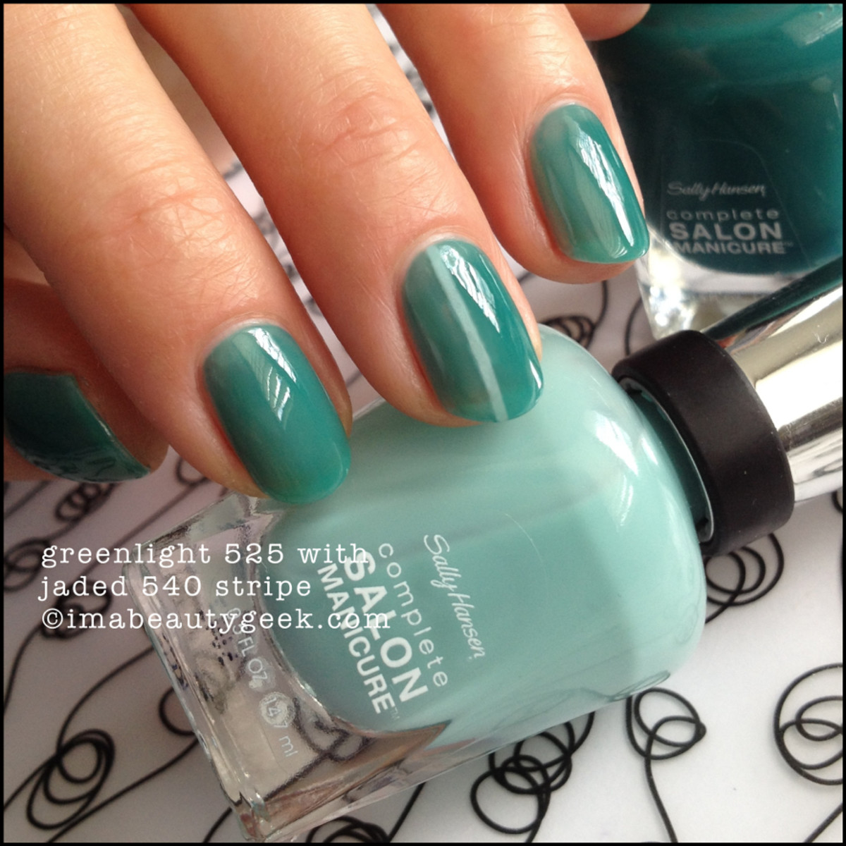 Tone-on-tone single-stripe mani in Sally Hansen Complete Salon Manicure in Jaded and Greenlight