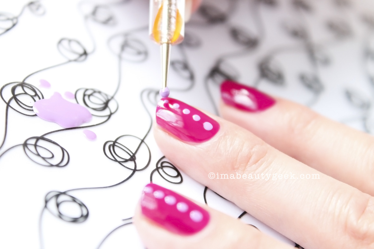 See? The ManiGeek arts! Here she uses Sally Hansen Complete Salon Manicure in Grape Gatsby.