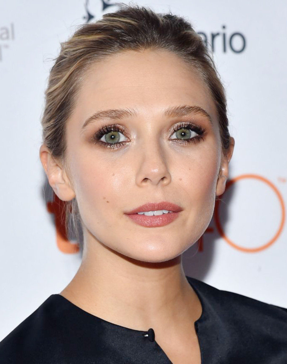 Elizabeth Olsen wears lip liner and lip balm on the red carpet at TIFF 2015