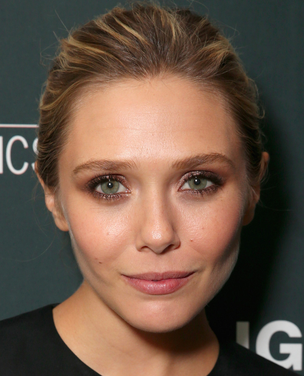 Elizabeth Olsen: shimmery bronze smoky eyes at TIFF 2015