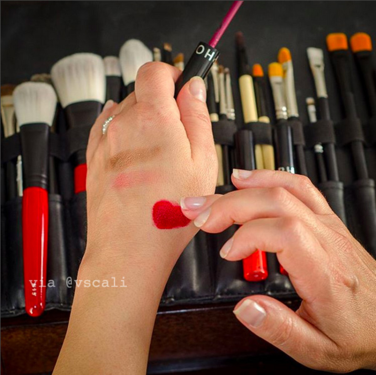 Celebrity makeup pro Vanessa Scali mixes two Sephora Collection Cream Lip Stain shades for Christina Hendricks, who attended the 2015 Emmy Awards on Sunday.