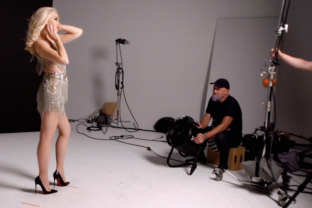 Behind the scenes: Gwen Stefani on the Revlon set; that's longtime hairstylist Danilo behind the fan.