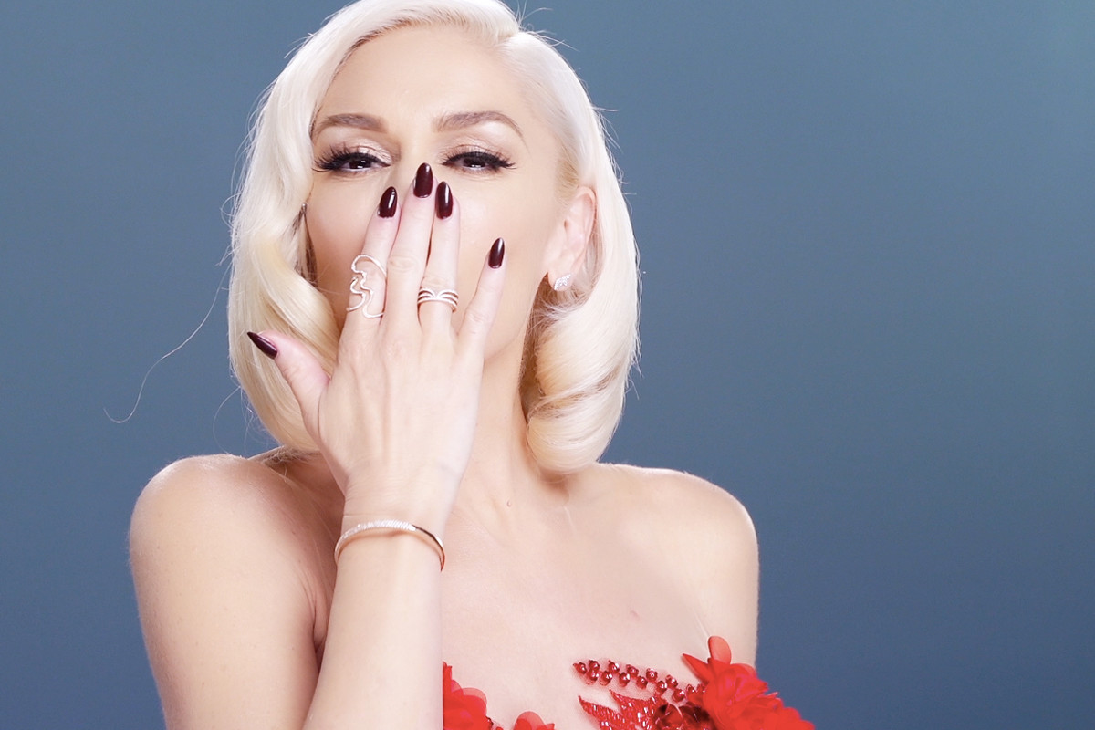 Gwen Stefani blows a kiss from the Revlon set