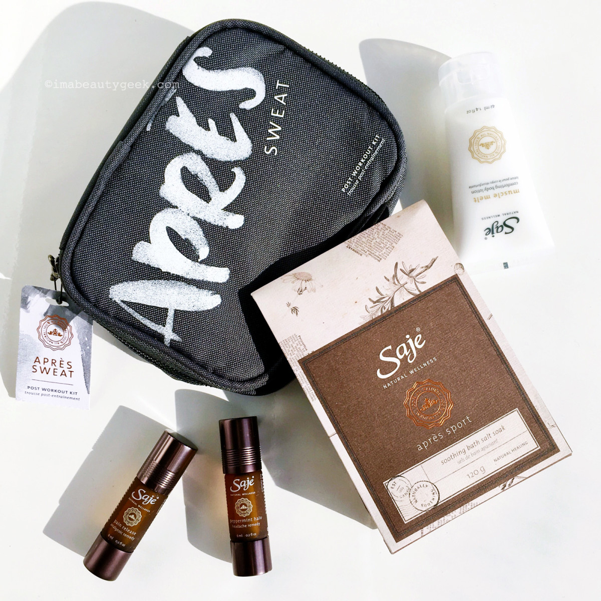 Saje Après Sweat Kit with bath soak, muscle-melt lotion, massage oil and soothing peppermint halo.