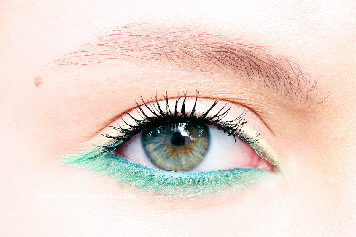 Erin wears Make Up For Ever Aqua XL waterproof eye pencil in M-40 Matte Yellow, M-34 Iridescent Pop Green, and along her lower waterline, I-24 Iridescent Blue