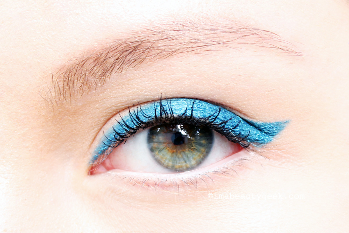 Erin wears Make Up For Ever Aqua XL waterproof eye pencil in 1-24 Iridescent Blue and M-16 Matte White