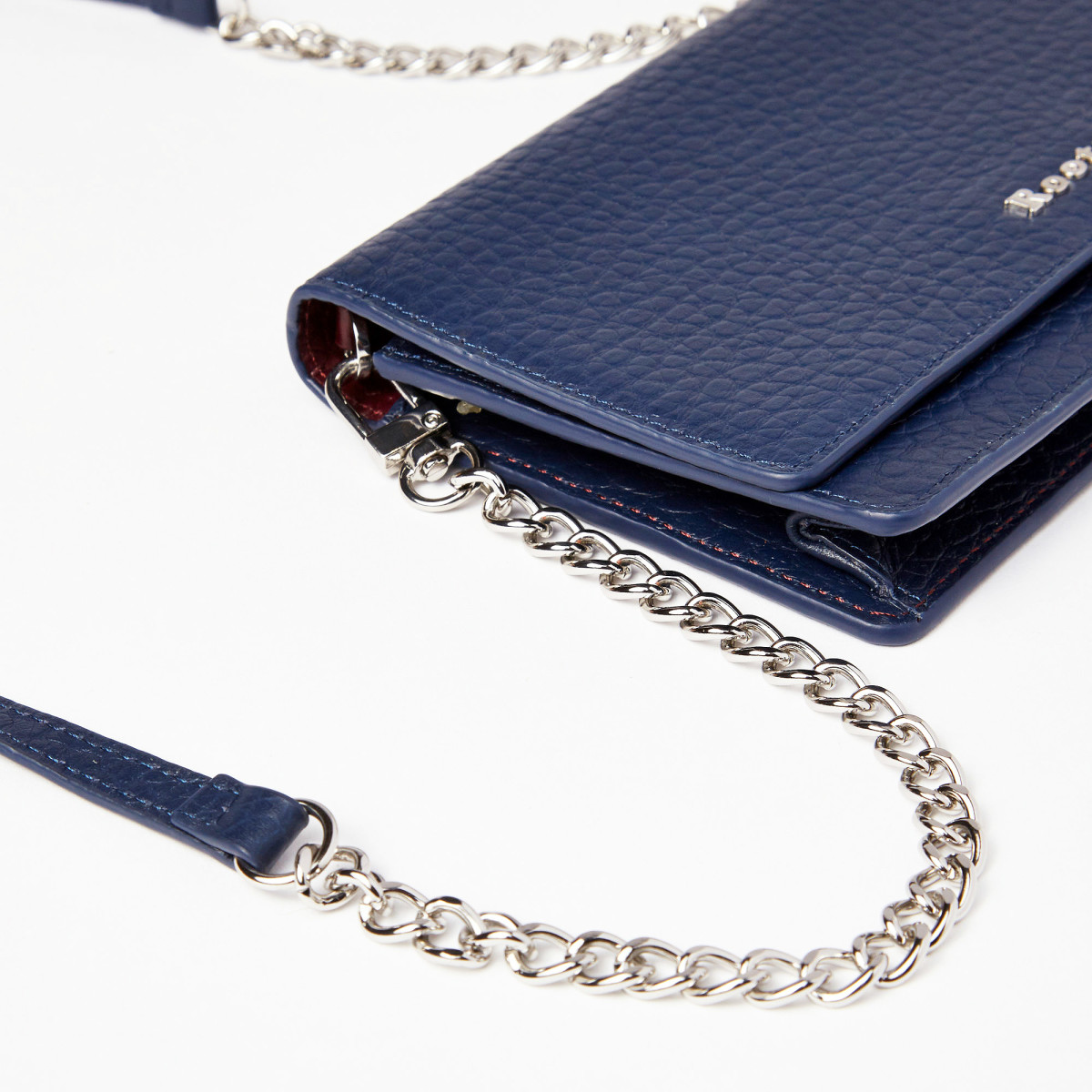 Roots Evening Wallet in Midnight Blue Prince leather with a removable shoulder strap