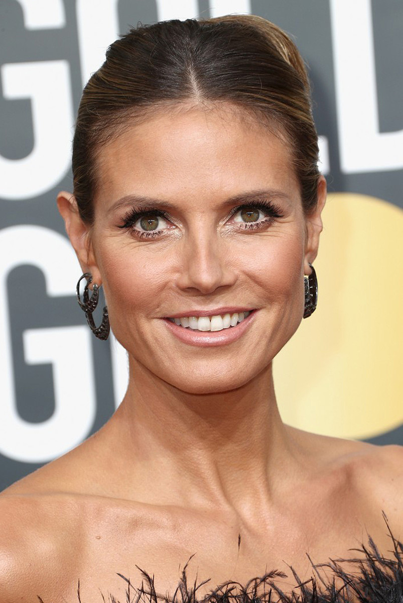 Heidi Klum on the 2018 Golden Globes red carpet; makeup by Linda Hay, hair by Andy Le Compte