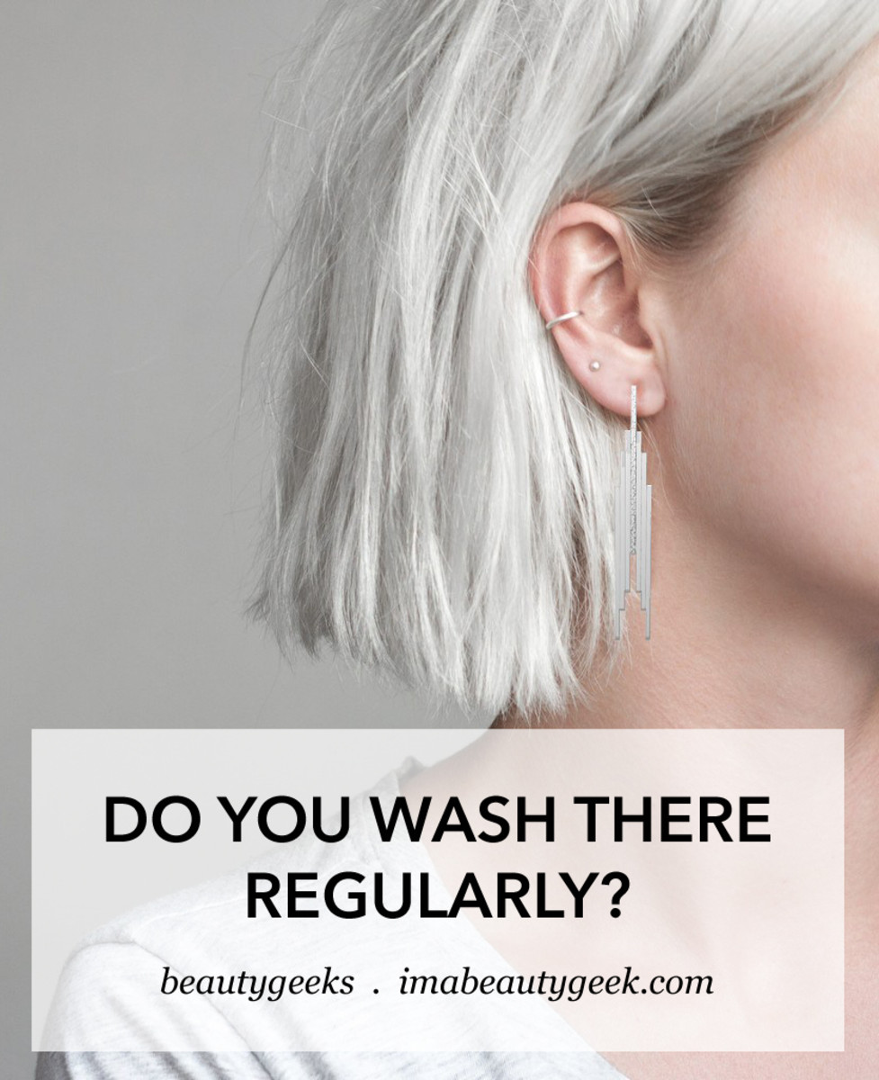 young woman white hair silver earrings_wash behind your ears
