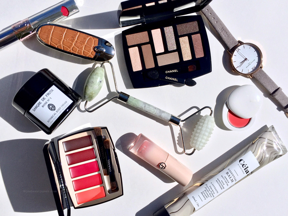 Clockwise from top left: Yves Saint Laurent Volupté Liquid Color Balm, Guerlain Rouge G Customizable Lipstick and Case, Chanel Les Beiges Natural Eyeshadow Collection, Olivia Burton London watch, Lilah B Tinted Lip Balm, Céla Essential Balm, Giorgio Armani Neo Nude A-Blush, Province Apothecary Dual Action Jade Facial Roller, Chanel La Palette Caractère Lipstick Palette, and Sangre De Fruta Rose Nº1 Botanical Body Cream